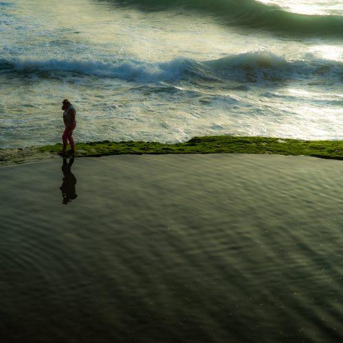 Man walking on the ocean